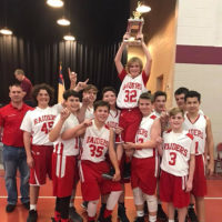 The Sacred Heart Catholic School Boy's Middle School basketball team celebrate after their December 16, 2017, win of the FCA Tournament B Division.